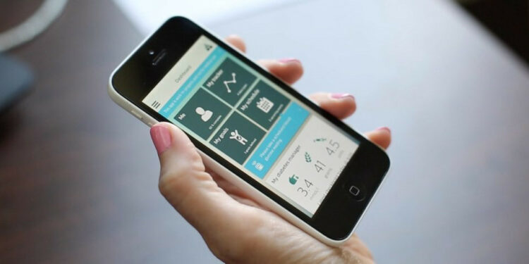 A hand with a smartphone with a medical app on the screen